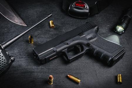 black 9mm pistol on a black wooden table