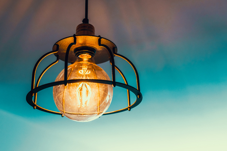 old lamp with a round bulb shines warm light