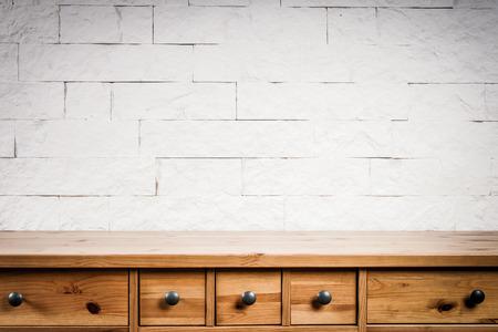 wooden shelf and wall of white bricks Stock Photo