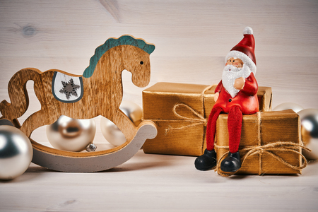 Christmas card with decorations on a wooden table with santa, gifts and horse Stock Photo