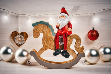 Christmas card with decorations on a wooden table with santa