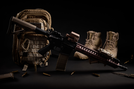 military wallpaper with an assault rifle on a black background Stockfoto - 93271342