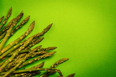 fresh asparagus arranged on a green summer background
