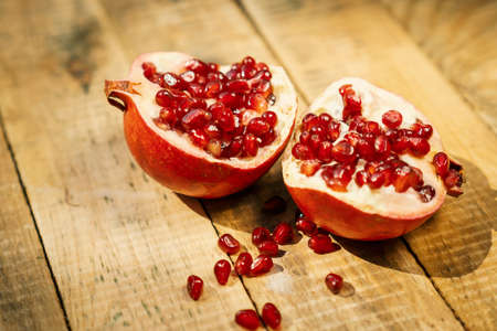 fresh pomegranate fruit on an old wooden table