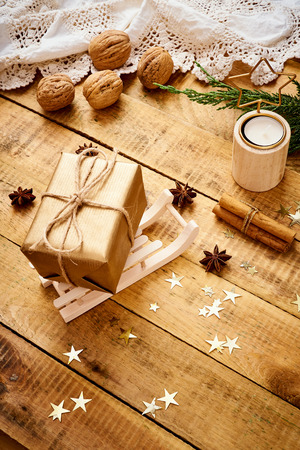 beautiful Christmas Eve background on an old wooden table with gifts and nuts decorations Stock Photo