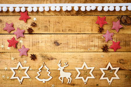 beautiful Christmas Eve background on an old table with wooden decorations