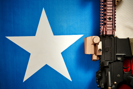 top view of a machine gun that is located on the background of the texas flag
