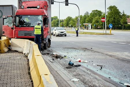 View of truck standing on the side of the street after road accident in the city.