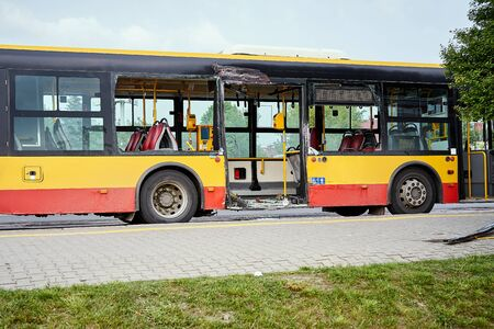 View of devastated city bus after road accident in the city. Stock Photo