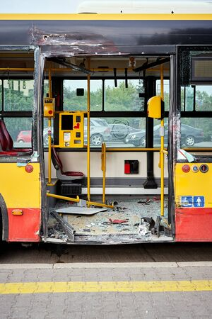 View of devastated city bus after road accident. Stock Photo