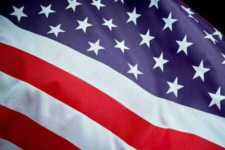 US flag waving in wind on Independence Day in America Stock Photo