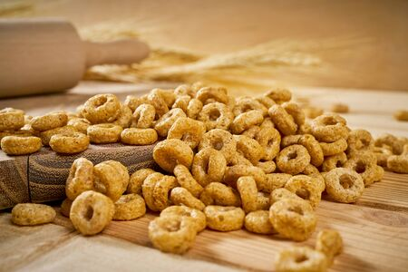 delicious crunchy breakfast on a wooden table with rye ears and a rolling pin 写真素材