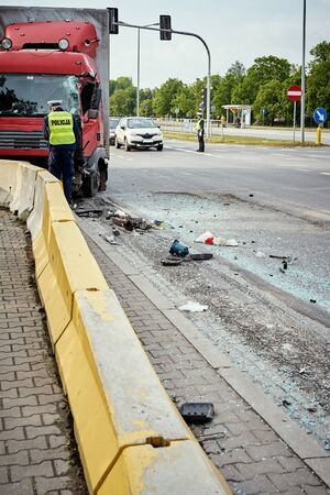 View of truck standing on the side of the street after road accident . Stock Photo
