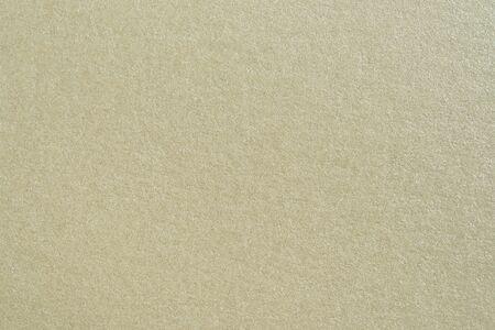 texture texture of beige handmade paper in macro Foto de archivo