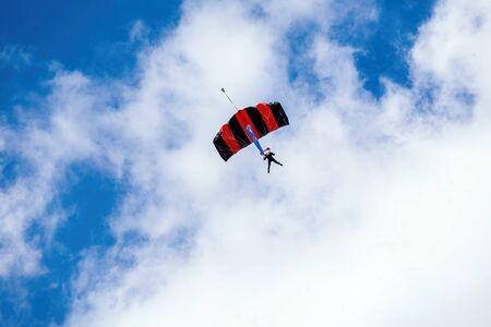 man flies on a parachute at the summer air show Stok Fotoğraf