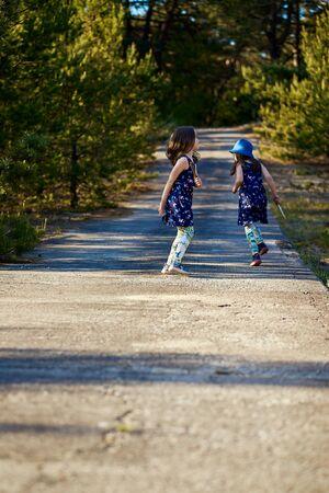 girl in a summer dress runs in a pine forest Standard-Bild - 149152870