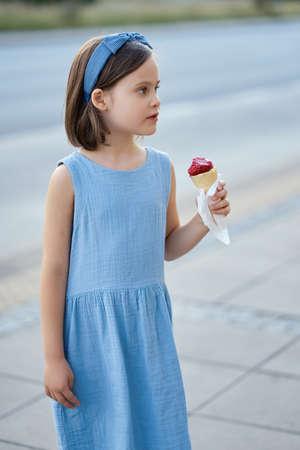cute girl walk around the city and eat ice cream