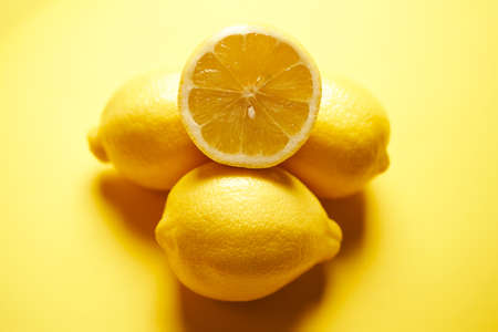 fresh lemons on a yellow minimalistic background