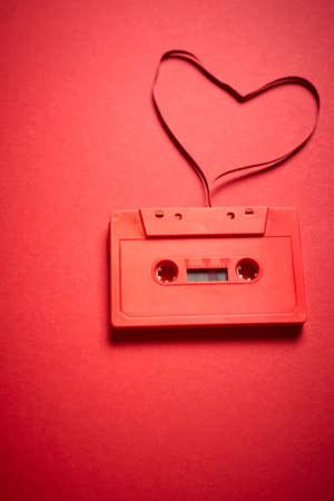 old red cassette tape on a minimalist background Foto de archivo
