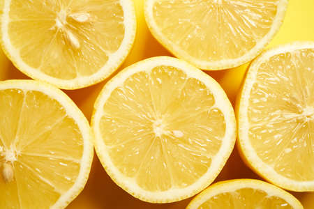 fresh lemons on a yellow minimalistic background Banco de Imagens - 153333383