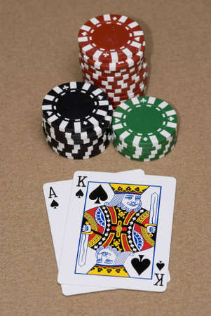 em: Ace King suited in a Texas hold em game. Editorial