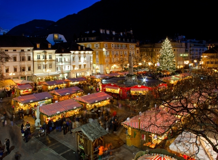 the stalls: Christmas market in Bolzano with lights and decorations