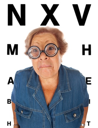Elderly woman withtable for eye exam Stock Photo