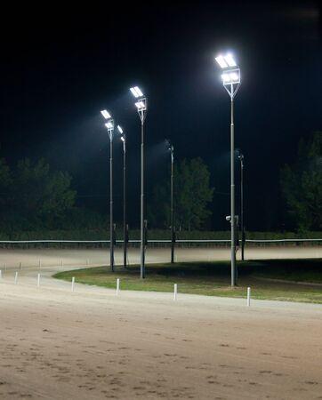 racehorses: Hippodrome of Agnano by night Stock Photo