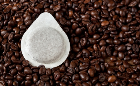 starbucks coffee: Coffee pods on coffee beans background