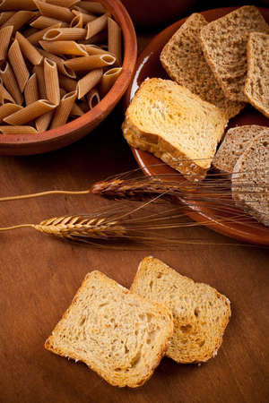 carbohydrates: Whole grain carbohydrates on wooden table