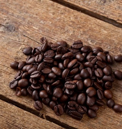 Coffee beans on rustic table photo