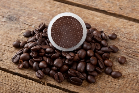 starbucks coffee: Coffee pods on wooden table