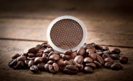 Coffee pods on wooden table Stock Photo - 18256460