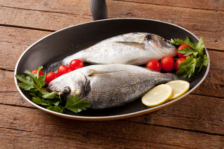 Two sea bream in pan photo