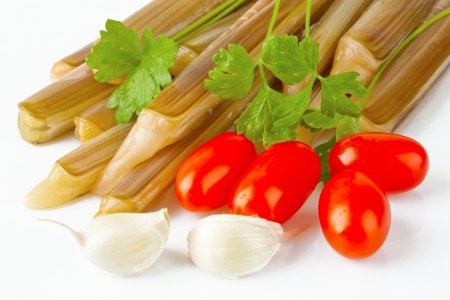 ensis: Ensis siliqua with tomatoes, garlic and parsley white background Stock Photo