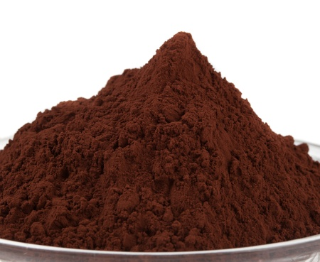 Cocoa powder isolated on white photo
