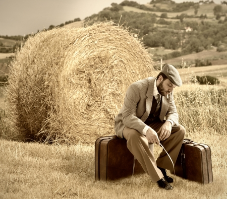 emigrant: Emigrant man with the suitcases in wheat field
