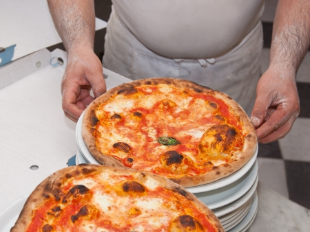 Margherita pizza cooked in wood oven photo