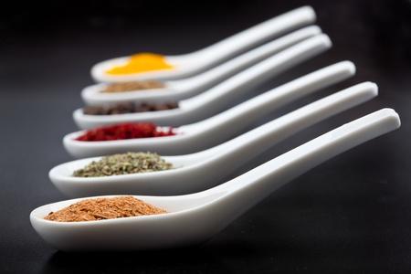 flavorings: Twelve spices on black background