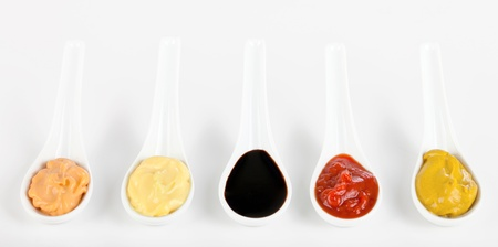 sauces: Sauces mixed in the ceramic spoons