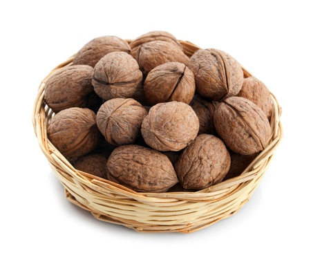 full willow: Wicker basket with walnuts isolated on a white background Stock Photo