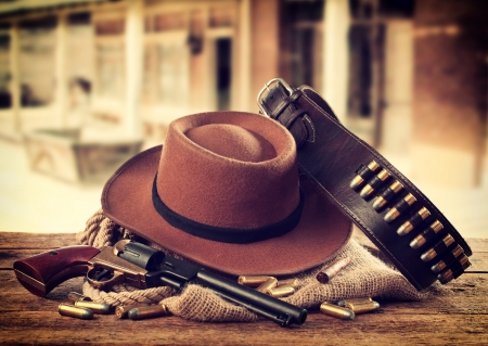 Western accessories on wooden table photo