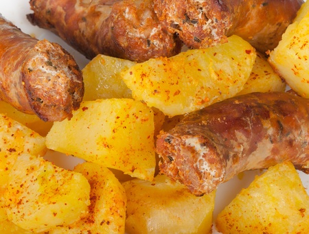 Grilled meat sausages with potatoes. Stock Photo - 18935355