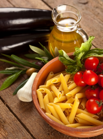 Ingredients of Pasta alla Norma on wooden table photo