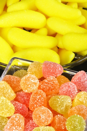 Mixed colorful jelly candies on black background photo