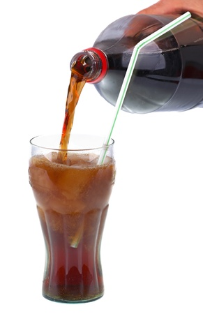 Glass of cola with ice on white background photo