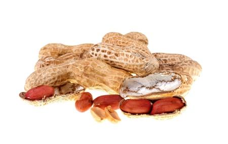 unpeeled: Peanut isolated on white background