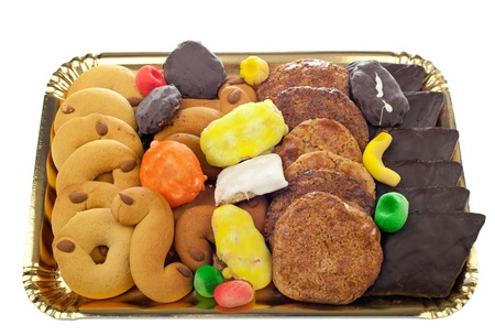neapolitan: Mix of pastries and cookies in the tray.