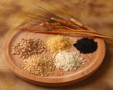 basmati: Five types of rice on wooden tray Stock Photo
