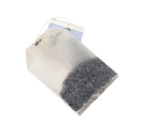 SIngle tea bag over a white background photo
